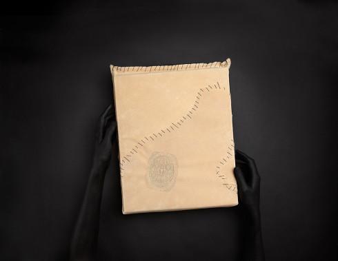 Stranger_HolidayBook_leatherwHands_F